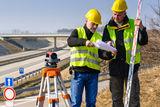geodesist-read-plans-construction-site-24471858